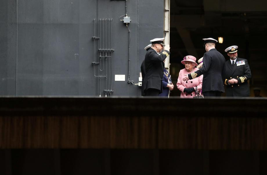 Britain's Queen Elizabeth attends the decommissioning ceremony for HMS Ocean at HMNB Devonport in Pl