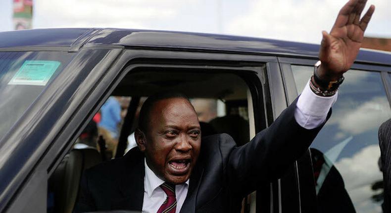 President Uhuru Kenyatta waving from his car