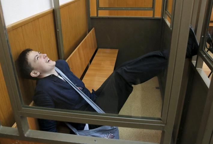 Former Ukrainian army pilot Savchenko reacts from glass-walled cage during verdict hearing at court
