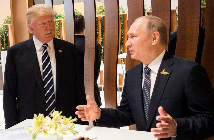 U.S. President Donald Trump and Russia's President Vladimir Putin shake hands during the G20 Summit