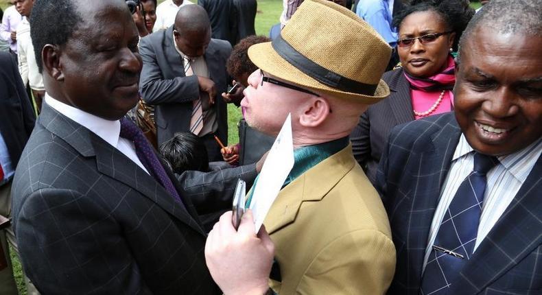 ODM leader Raila Odinga and nominated MP Isaac Mwaura