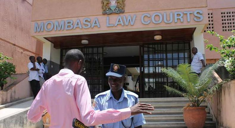 An officer conducts a search at the Mombasa Law Courts (Twitter)