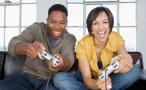 Young black couple playing video games