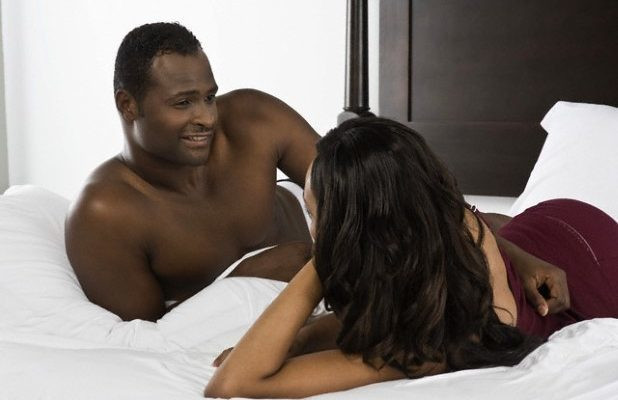 Black couple in bed (Courtesy)