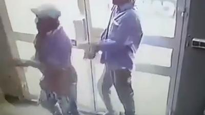 Video: Crippled men rob bank at gunpoint