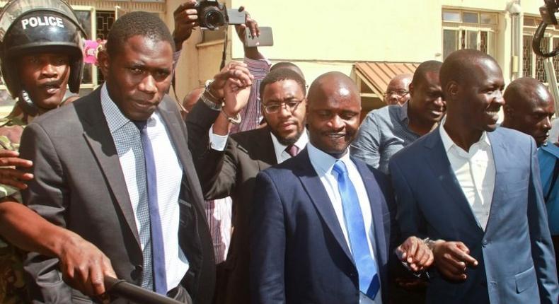 Kenya Medical Practitioners and Dentists Union's (KPMDU) Secretary General, Dr Ouma Oluga (L), Chairman Dr Samuel Oroko (C) and Dr Allan Ochanji (R) are led away in handcuffs in Nairobi on February 13, 2017