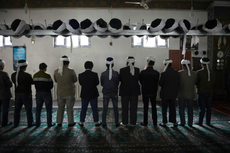 The ethnic Uighur population, seen here praying in a mosque, is the largest group to face extra-judicial detention in China's western Xinjiang region