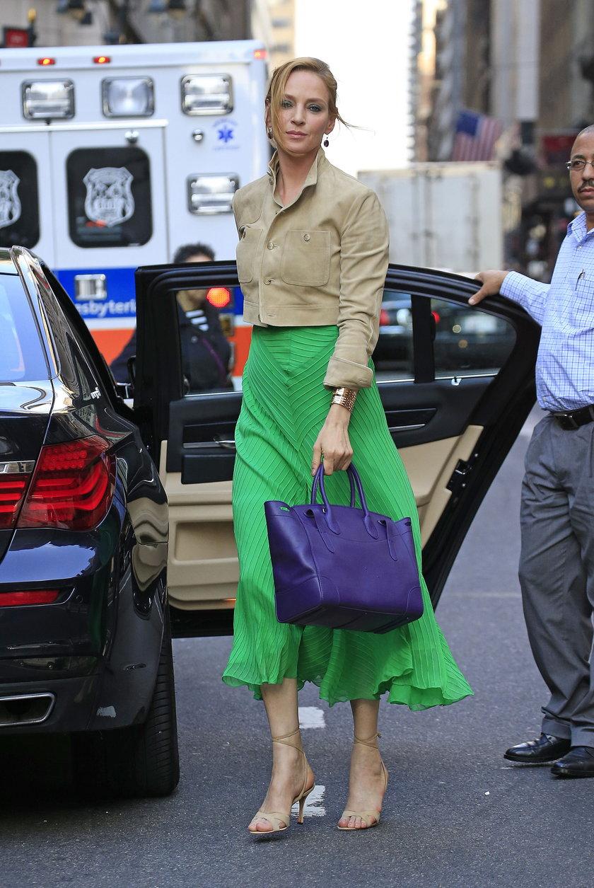 Uma Thurman wears a long green skirt in New York City