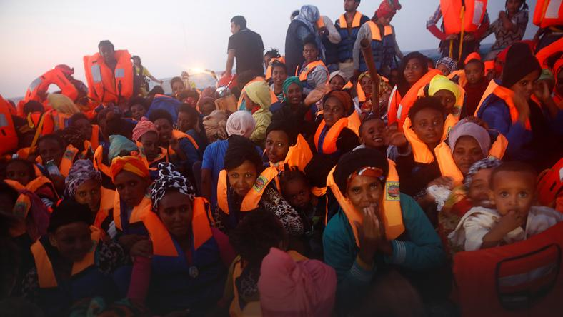 Migrants from Eritrea are seen on an overcrowded wooden vessel during a rescue operation by the Spanish NGO Proactiva, off the Libyan coast in Mediterranean Sea