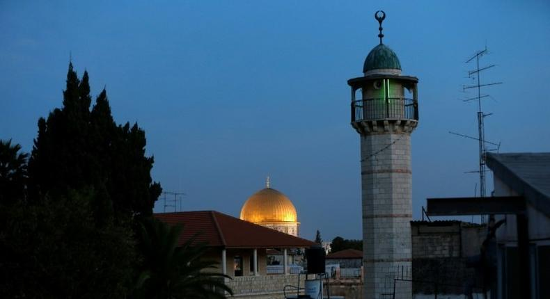 The minaret of a mosque and the Dome of the Rock in a Palestinian neighbourhood in east Jerusalem's Old City