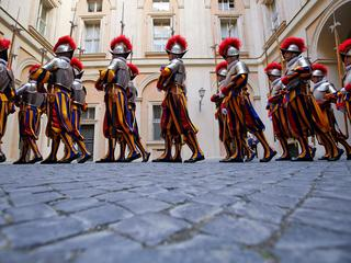 New recruits of the Vatican's elite Swiss Guard march before their swearing-in ceremony at the Vatic