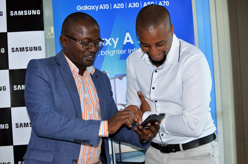 Samsung Electronics East Africa Head of Internet and Mobile department Charles Kimari (left) and Ryan Mule, Product Marketing Manager Samsung Electronics East Africa (right) admiring the galaxy A series phone. (George Tubei)