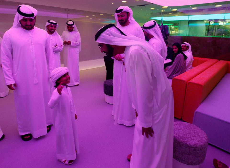 Sheikh Mohammed bin Rashid Al Maktoum talks with a child during the official opening ceremony of the