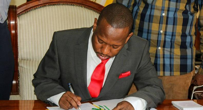 Nairobi Governor Sonko signing a document