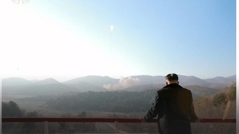 North Korean leader Kim Jong Un watches a long range rocket launched into the air in this still image taken from KRT footage and released by Yonhap