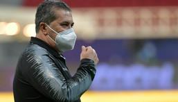 Venezuela's Portuguese coach Jose Peseiro surveys the field at Mane Garrincha Stadium in Brasilia Creator: Nelson ALMEIDA