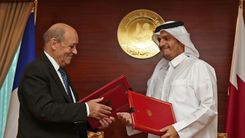 "Qatar's Foreign Minister Mohammed bin Abdulrahman Al-Thani (R) met with his French counterpart Jean-Yves Le Drian in Doha to sign the ""strategic dialogue"" agreement on February 11, 2019"