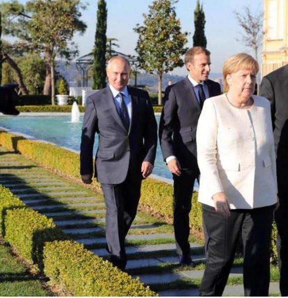 Vladimir Putin, Emanuel Makron i Angela Merkel