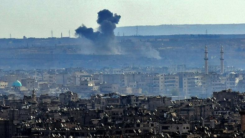 Smoke billows from the southern suburbs of Aleppo during fighting between regime forces and rebel fighters on December 3, 2016