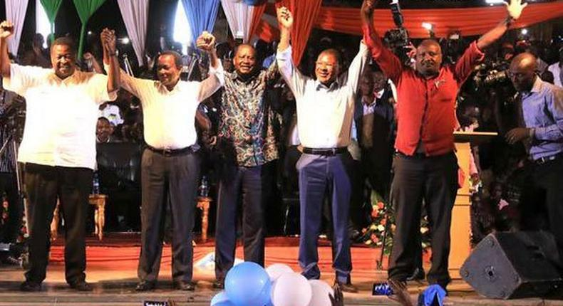 From left: Opposition leaders Musalia Mudavadi, Kalonzo Musyoka, Raila Odinga, Moses Wetang'ula and Nick Salat display a gesture of unity during the unveiling of an opposition coalition at Bomas of Kenya on January 11, 2017.