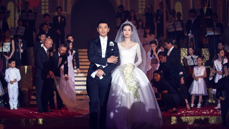 151009 SHANGHAI Oct 9 2015 Actor Huang Xiaoming and actress Angelababy walk together d