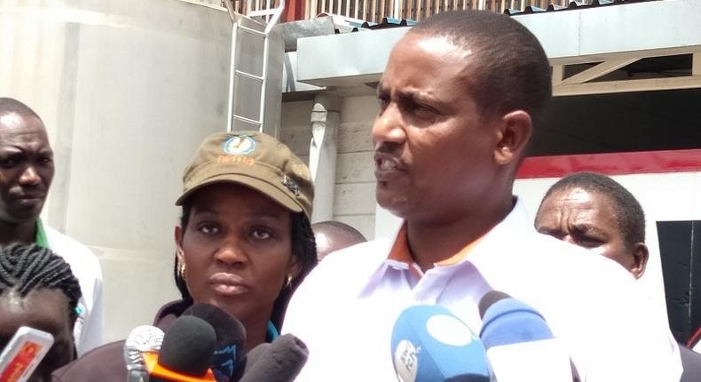 NEMA officials after inspecting Daima milk processing plant at Sameer Industrial Park. They discovered disposal of untreated effluent into the Nairobi sewer system