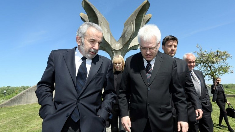 Coordinator of the Jewish communities in Croatia Ognjen Kraus (L) and Croatian rabbi of the Jewish community Luciano Mose Prelevic (R) walk in front of a memorial in the shape of a flower in Jasenovac on April 15, 2016