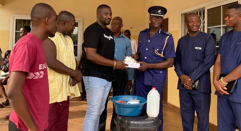 John Dumelo donates items to Ayawaso West police officer to fight coronavirus