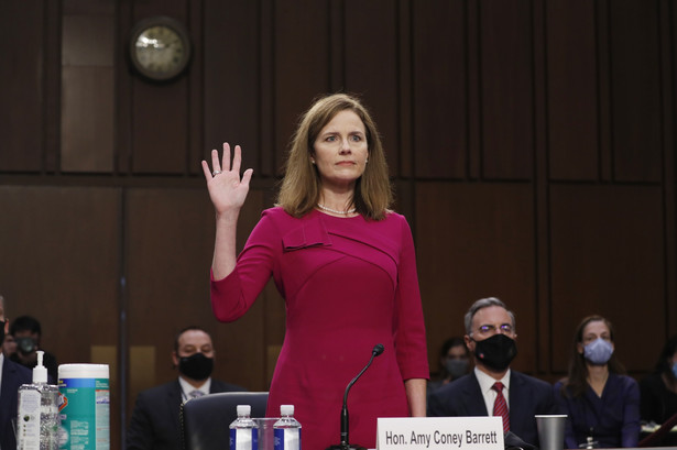 Amy Coney Barrett swears in to a Senate Judiciary Committee confirmation hearing in Washington, D.C., on Oct. 12. Photographer: EPA/Pool/Bloomberg