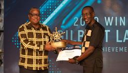 KPA Ag. Managing Director Amb. John Mwangemi (left) handing over certificate to winner of Lifetime Achievement Award Gilbert Langat at the EAMA 2020 Awards