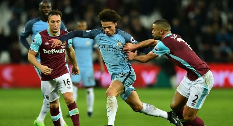 Manchester City's midfielder Leroy Sane (C) vies with West Ham United's midfielder Mark Noble (L) and defender Winston Reid during the English Premier League football match between February 1, 2017