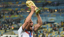 Germany defender Benedikt Hoewedes celebrates winning the 2014 World Cup in Brazil Creator: PATRIK STOLLARZ