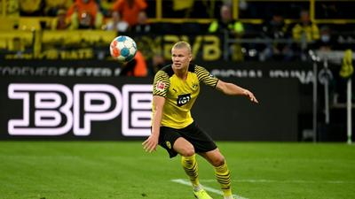 Haaland double sees Dortmund hold off Union to climb to second