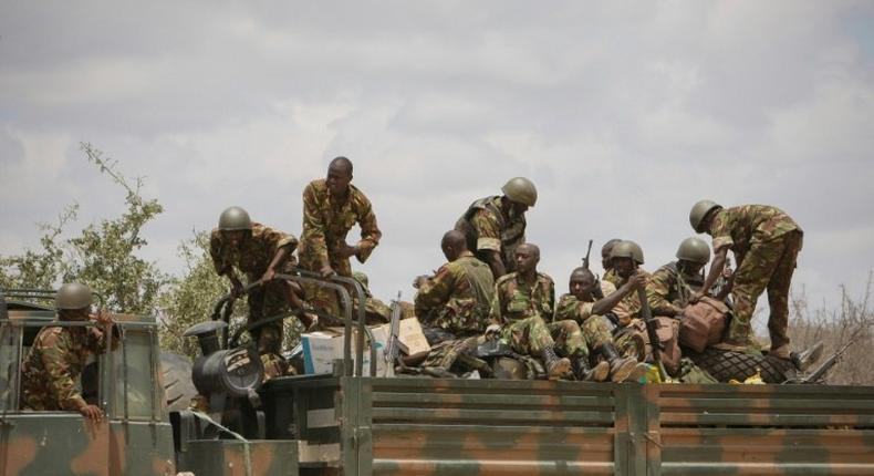 Soldiers of the Kenyan contingent serving with the African Union Mission in Somalia (AMISOM) load a truck as part of a resupply convoy in Dhobley, southern Somalia