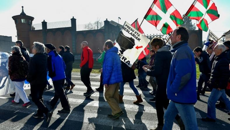 People holding Basque flags demonstrated in December outside Basauri jail near Bilbao for the release of ETA-linked prisoners -- but some relatives of the group's victims strongly oppose detainees being brought closer to home