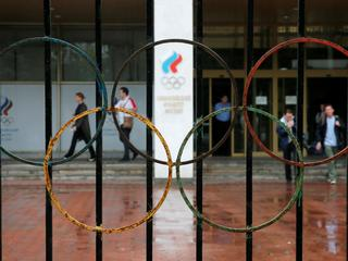 People walk out of the Russian Olympic Committee headquarters in Moscow