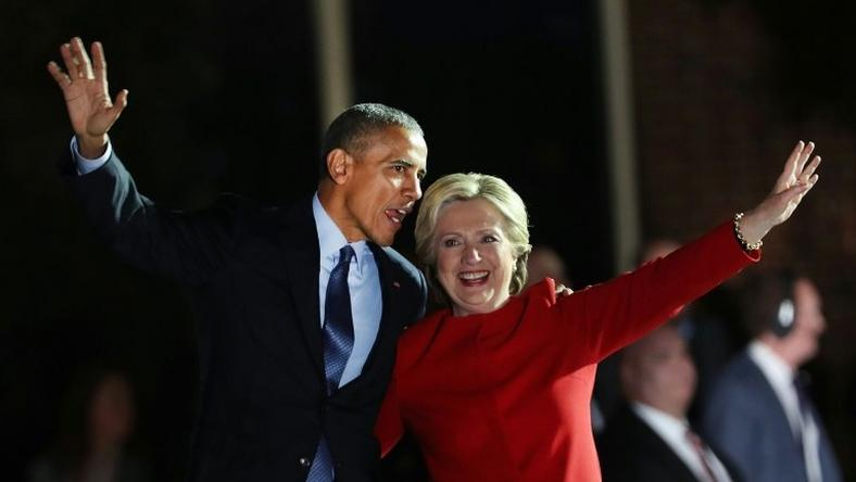 Hillary Clinton stands with Barack Obama at an election eve rally on November 7, 2016 in Philadelphia, Pennsylvania