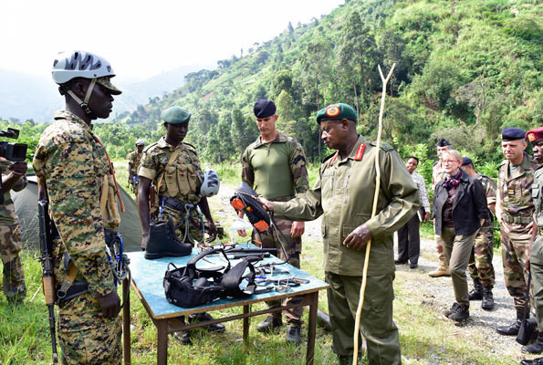 Uganda's President Ywoeri Museveni inspects military equipment used by UPDF solders undertaking the mountain warfare. (Strategic Intelligence Service)