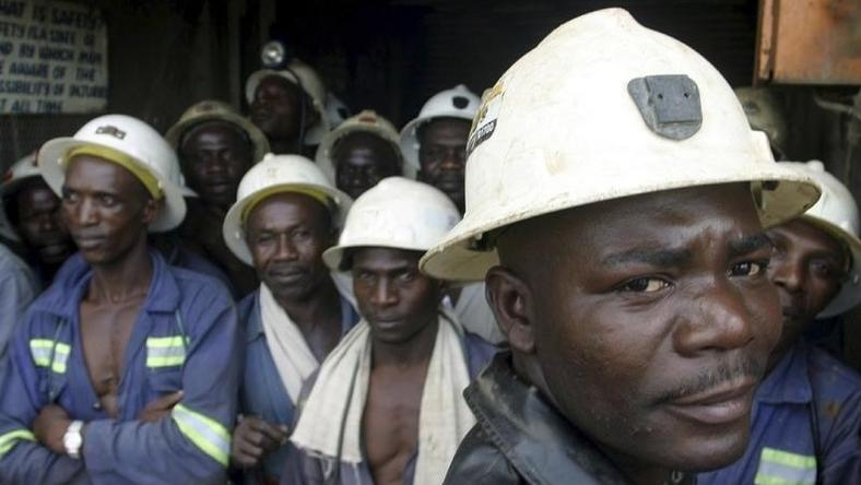 Konkola Copper Mines PLC workers wait in a lift before going to work underground in Konkola, in this file photo. DAVOS/AFRICA REUTERS/Stringer