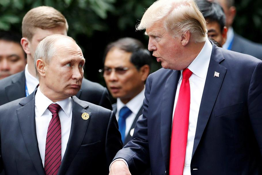 FILE PHOTO: U.S. President Donald Trump and Russia's President Vladimir Putin talk during the family
