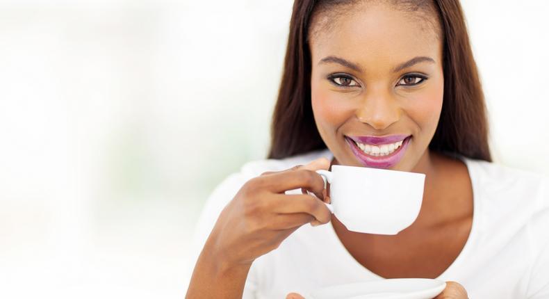 Beautiful woman drinking tea at home