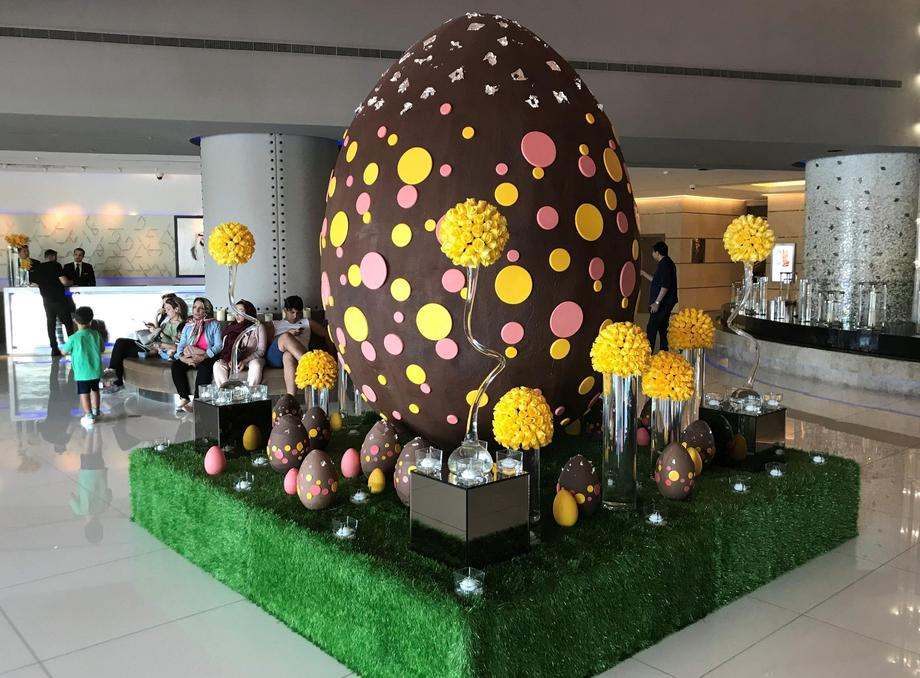 Easter egg weighing 80 kilos, that is partially made of dark chocolate is displayed at hotel in Duba