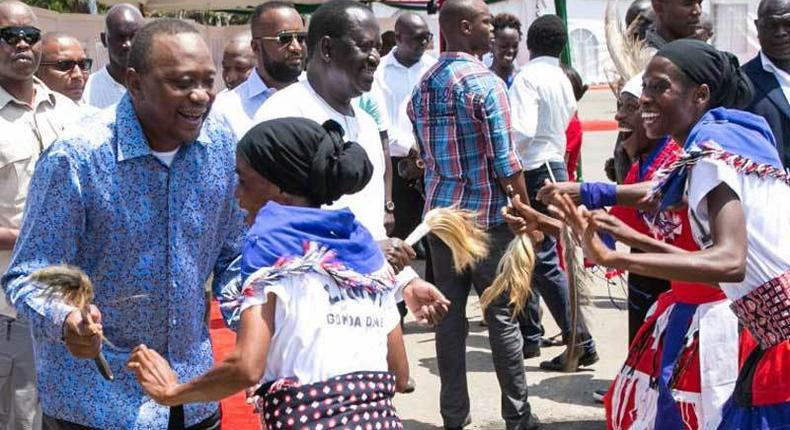 President Uhuru Kenyatta and opposition leader Raila Odinga join Mjikenda traditional dancers for a dance at a past event. (The Standard)