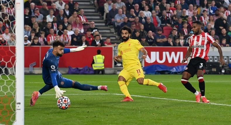 Mohamed Salah (C) scores for Liverpool in a 3-3 Premier League draw at Brentford Creator: Glyn KIRK