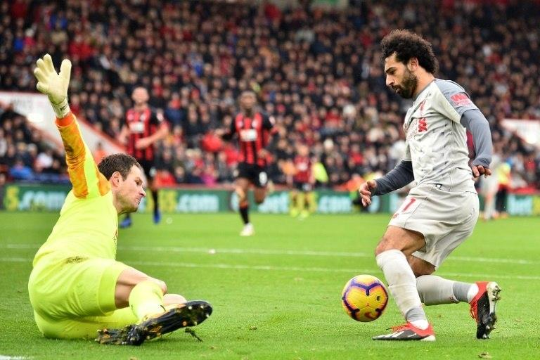 Liverpool's Mohamed Salah completes his hat-trick in a 4-0 win at Bournemouth on Saturday