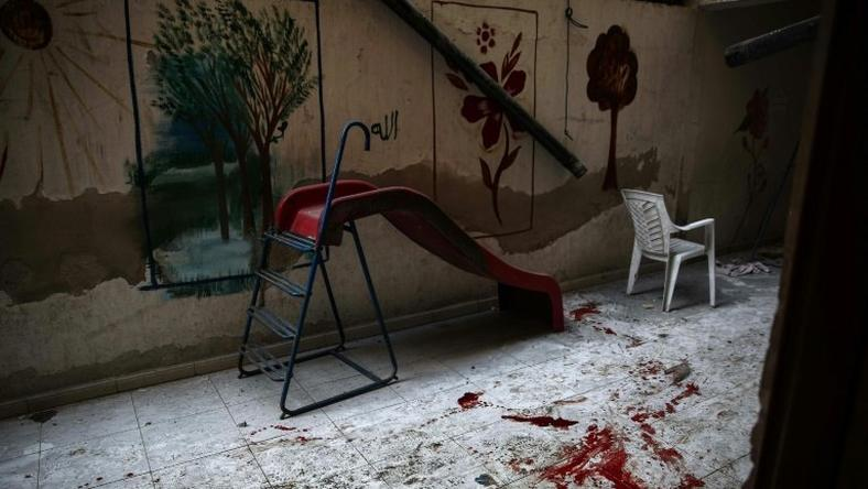 The blood-stained floor of a kindergarten following reported shelling in the rebel-held area of Harasta, on the northeastern outskirts of Damascus, on November 6, 2016