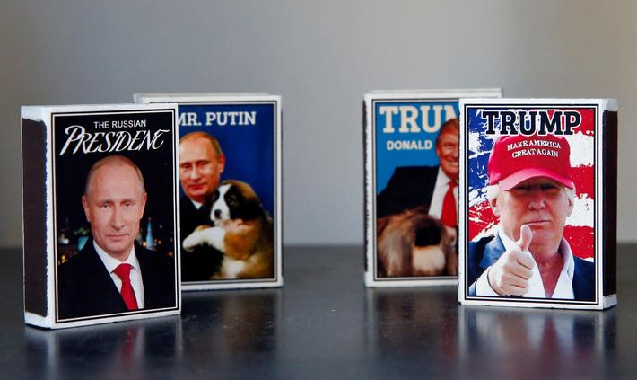 Matchboxes with pictures of President Putin and President Trump are seen in a shop window in Helsink