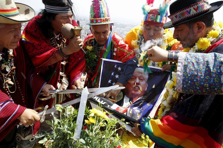 Peruvian shamans holding a poster of U.S. Republican presidential candidate Donald Trump perform a r