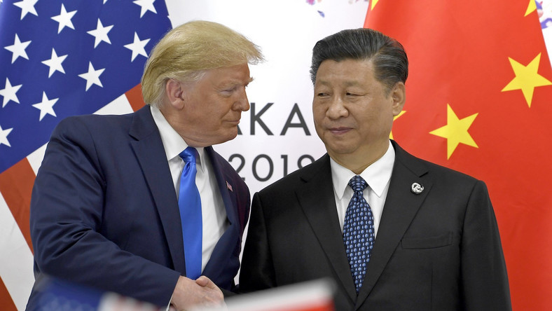 In this June 29, 2019, file photo, U.S. President Donald Trump, left, shakes hands with Chinese President Xi Jinping during a meeting of the G-20 summit in Osaka, western Japan.