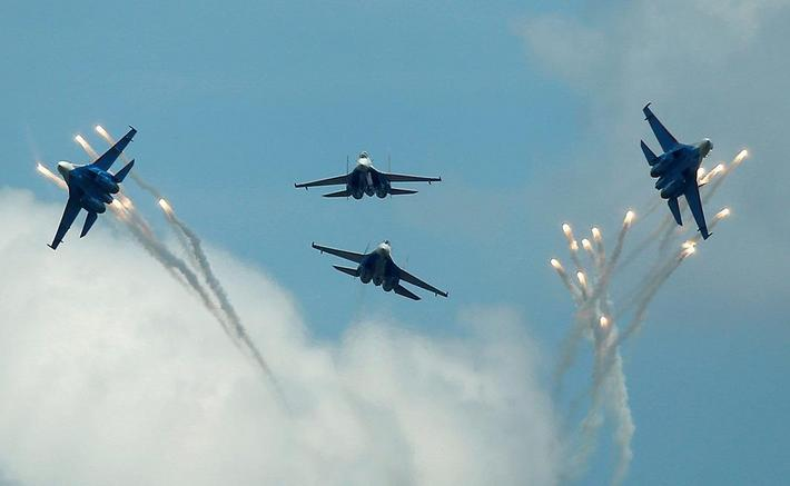 Sukhoi Su-27 jet fighters of Russkiye Vityazi aerobatic team fly in formation during International A